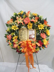 Wreath with a picture frame from Carter's Flower Shop in Farmville, VA